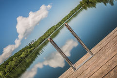 Bathing pond with wooden pier Royalty Free Stock Photo