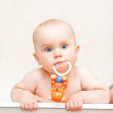Bathing with rattle. Little baby girl bathing with rattle royalty free stock photos