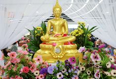 Buddha statue placed among the flowers. Songkran festival Thailand. Bathing rite for Buddha image in Songkran festival Thailand. during April of 13th - 15th Royalty Free Stock Photography