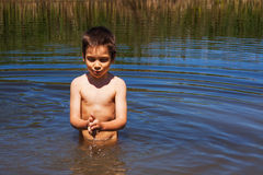 Bathing in river. Boy bathing in river in a summer day royalty free stock photo