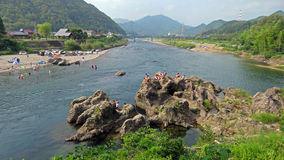 Bathing in the river in Mino in Japan. Relaxing on a hot summerday in cool water of Nagara river stock photos