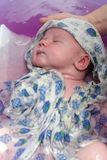 Bathing of sleeping baby Royalty Free Stock Photography