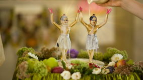 Bathing statuette of deities stock footage