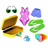 Bathing Suits and travelling bag Stock Images