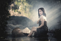 Bathing woman. The girl was bathing in the brook,woman washing in the stream,country girl portrait in outdoors,beautiful happy Asian girl smile and laugh royalty free stock photography