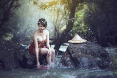 Bathing woman. The girl was bathing in the brook, woman washing in the stream, country girl portrait in outdoors Stock Photo