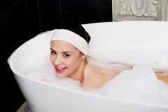 Bathing woman relaxing in bath. Royalty Free Stock Photo