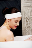 Bathing woman relaxing in bath. Royalty Free Stock Photo