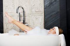 Bathing woman relaxing in bath. Stock Image
