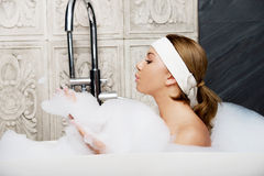 Bathing woman relaxing in bath. Stock Images