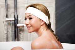 Bathing woman relaxing in bath. Stock Photos