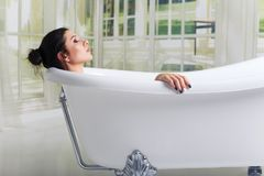 Bathing woman relaxing in bath smiling relaxing with eyes closed stock photo