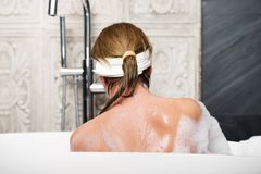 Bathing woman sitting in bath. Royalty Free Stock Photo