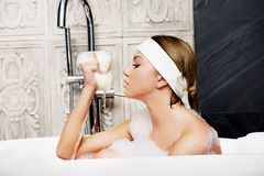 Bathing woman with sponge. Stock Photos