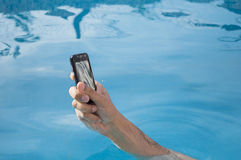 Bathing with your mobile without getting wet Royalty Free Stock Images