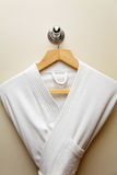 Bathrobe. Clean bathrobe on the hangers royalty free stock images