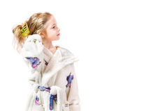 Bathrobe. Young girl with bathrobe on white background Royalty Free Stock Photography