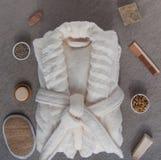 Bathrobe bath soap and loofah, herbs on a stone. Background Royalty Free Stock Photos