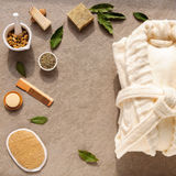 Bathrobe bath soap and loofah, herbs on a stone. Background Royalty Free Stock Image