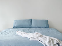Bathrobe On Blue Bed Stock Photography
