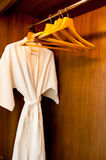 Bathrobe and Hangers Stock Photo