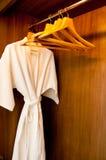 Bathrobe and Hangers Stock Photo