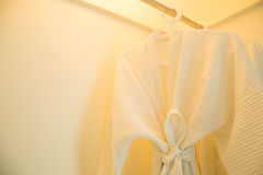 Bathrobe. Hanging in the closet royalty free stock images
