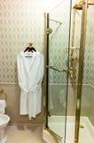 Bathrobe In Hotel Bathroom. Retro style interior royalty free stock image