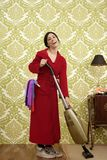 Bathrobe retro housewife woman vacuum cleaner Stock Photos