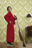 Bathrobe retro housewife woman vacuum cleaner Royalty Free Stock Photography