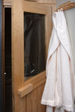 Bathrobe beside sauna Royalty Free Stock Photo