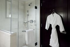 Bathrobe and shower Stock Photos