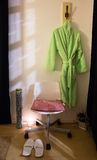 Bathrobe and slippers. A corner of the massage room Royalty Free Stock Photo
