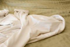 Bathrobe Tight. A bathrobe on an unmade bed Stock Images