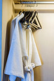 Bathrobe in wardrobe. Royalty Free Stock Photo