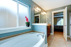 Bathrom interior in aqua tone with white bath tub Stock Images