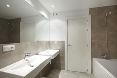 Bathrom interior with marble brown walls Stock Photos