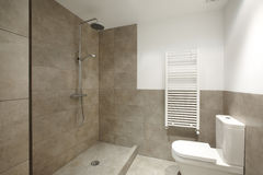 Bathrom interior with marble brown walls Stock Images