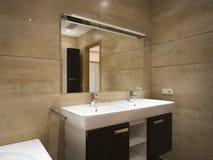 Bathroom. New designer modern bathroom with door to living room Royalty Free Stock Images