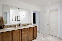 Bathroom. View of cabientry, sinks, and mirror Royalty Free Stock Image