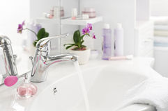 Bathroom. Water pipe close up in bright bathroom Stock Images