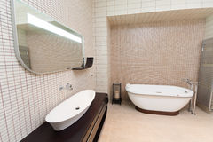 Bathroom. Comfortable bathroom is in  a modern house Royalty Free Stock Photography