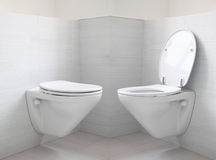 Bathroom. White toilet bowl at bathroom, opened and closed Stock Photo