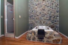 Bathroom. Elegant bathroom design done on decorative rock and hardwood floors Royalty Free Stock Photography