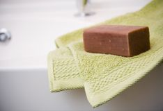 Bathroom. Green towel and brown soap in bathroom Royalty Free Stock Photo