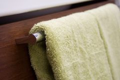 Bathroom. Green towels and dark brown bathroom furniture Royalty Free Stock Photography