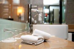 Bathroom. Folded plush towels in a bathroom Stock Photography