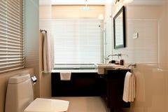 Bathroom. Small bathroom detail with toilet, sink and bath tub Royalty Free Stock Photos