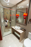 Bathroom. Simple modern bathroom,including separate shower in glass wall, wash basin and Mirror Stock Image