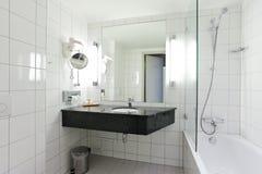 Bathroom. A bathroom with white tiles stock photo